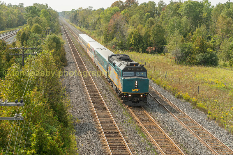 With both the CN Kingston sub & CP belleview sub running paralell here at the end of CP.s grafton siding ( out of shot over my shoulder) this local road over bridge provided a cracking vantage point.   Here Via Rails train 644 the daily 1320 Toronto - Ottawa passes at speed ,  friday 15-09-17