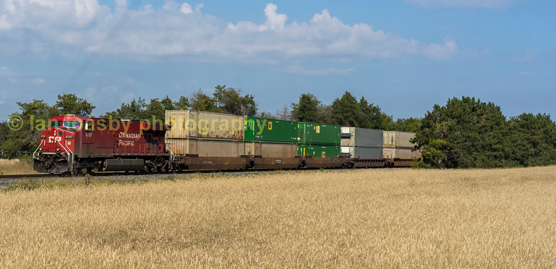 Canadian Pacific Gevo powered ES44AC  8787 heads a Toronto bound intermodel just north of Spence yd on the Mactier sub