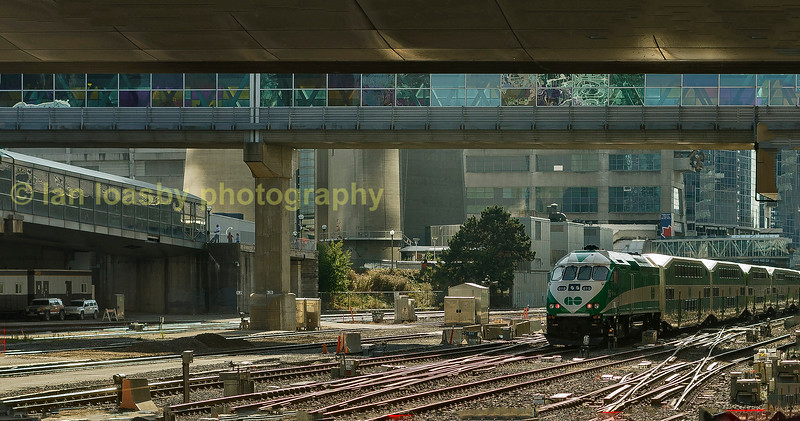 MP40 619 propells its train west out of union station