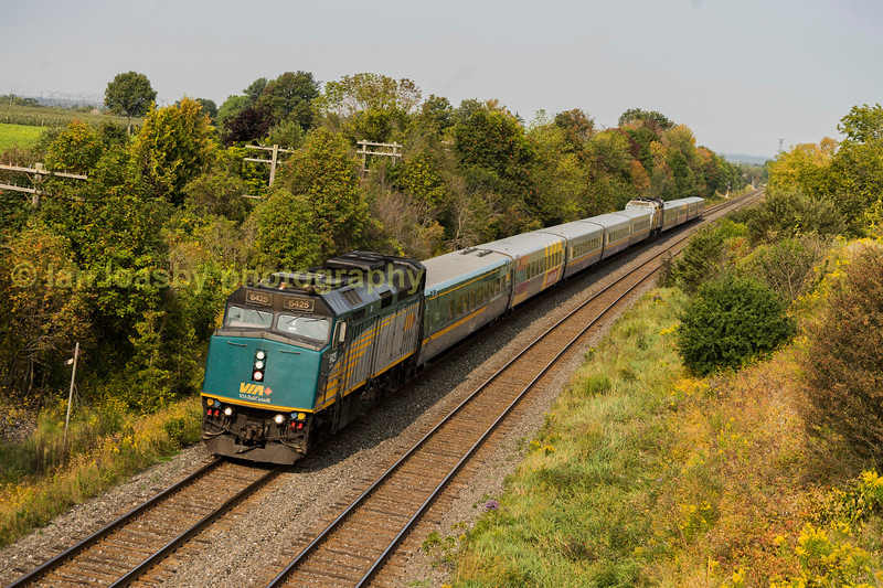 Via (pronounced (VE - AH) rail train number 62 the 0925 Toronto -  Ottawa service  and the 0920 Toronto- Montreal service run as one train coupled together as far as Brockville where the train splits and carries on to their resected destinations, the train is seen here on the CN  Kingston Sun  near Grafton the train is also referred to as the J train.  The lead loco is a EMD F40PH no 6425 with class mate 6416 in the rear.