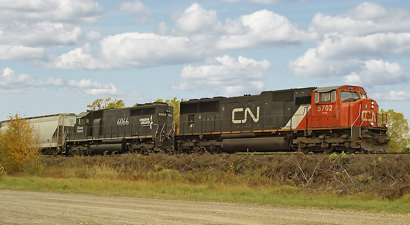Taken in Fort Frances.<br /> <br /> CN 5702 and IC 6066 heading to the border.