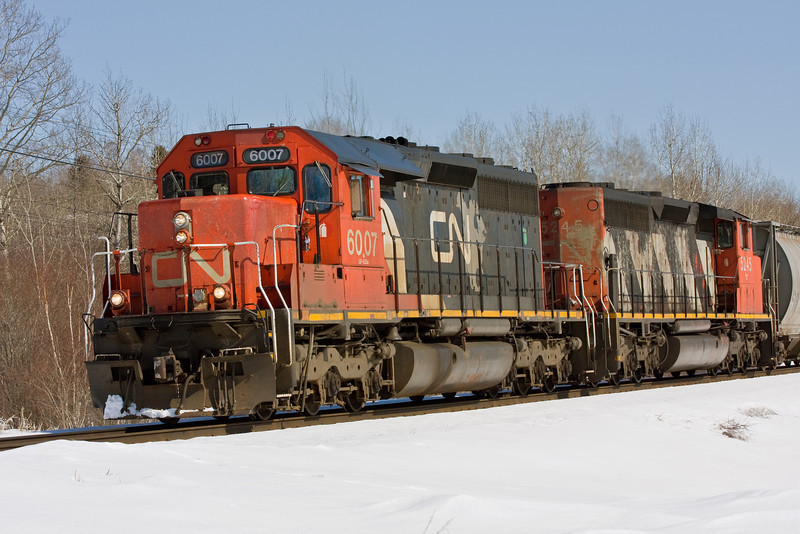CN train 303 with CN 6007 (SD40-2Q) and CN 5245 (SD40-2W) leaves Sioux Lookout, Ontario.