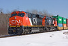A pair of CN ES44DC's pull train 101 from Sioux Lookout, Ontario on a nice sunny winter day. These locomotives are also sisters - locomotives 2300, and 2301. Considering the nice bright new paint and the fact they are together like this, I wonder if they are fresh from being manufactured.