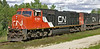 CN 5761  - a GMD SD75I, heads west through Aimsdale, Ontario
