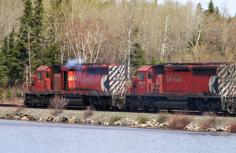 CP 5759 traveling west through Wabigoon Ontario. The crew seems to be having problems with the lead unit.<br /> <br /> Photo taken My 22, 2004 with a Canon10D, 1/400 second, f 8 and ISO 200.