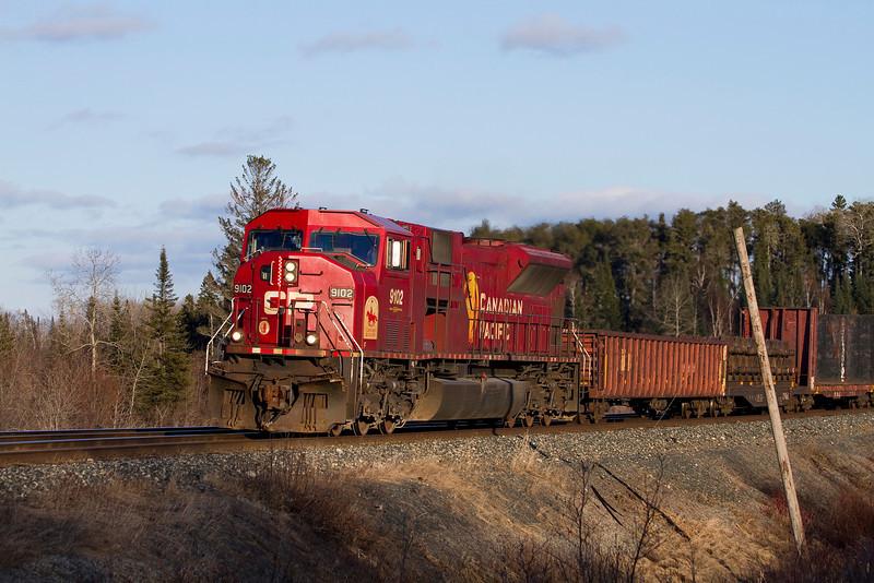 CP 9102 near Barclay Ontario with a mixed train.