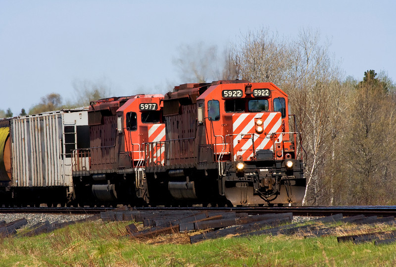 A pair of SD-40-2's, CP 5922 and CP 5977, heading for Barclay Ontario (photo taken at Island View Road) on a bright sunny morning.<br /> <br /> This photo is larger than usual. Total file size is 4.55 MB.