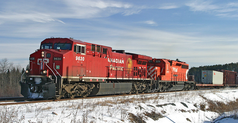 CP 9630, and CP 5771 at Barclay, Ontario. <br /> <br /> Locomotive 5771 is referred to as a 'slug'. The conductor and trainmans seats have been removed, along with other items in the cab. All that is left in the cab is the engineers seat and control stand in case the unit had to be moved with out the aid of another locomotive.