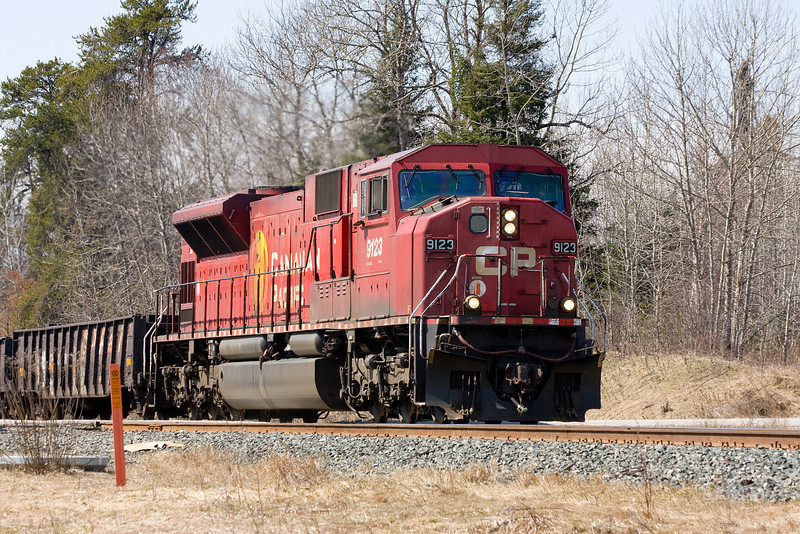 Work train CP 9123, a GMD SD90MAC, heads east out of Dryden.
