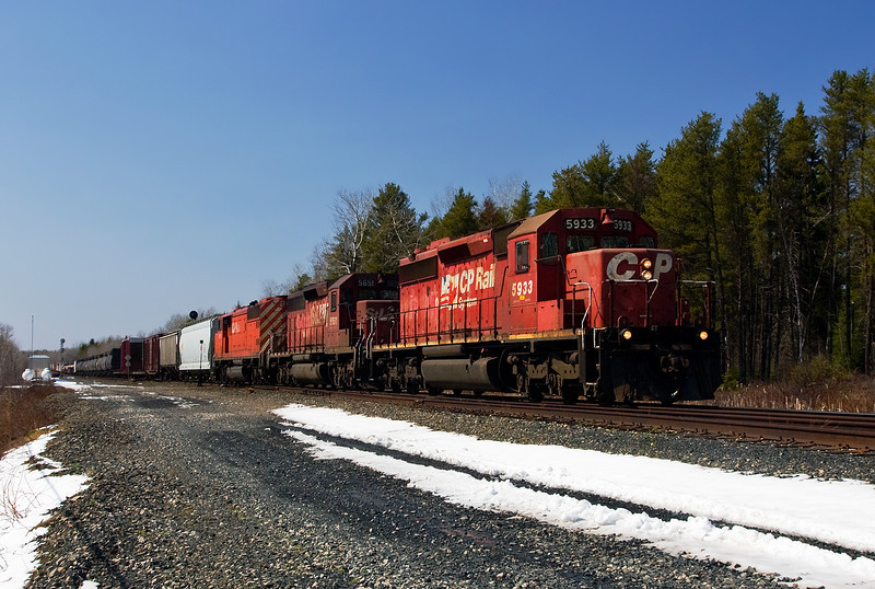 CP 5933, a GMD SD40-2, a head of a EMD SD40-2 painted in StL&H scheme, and a 9000 series SD40-2F (I did not catch the unit number).<br /> <br /> Photo taken at crossing on Bonny Bay Rd (east of Dryden).