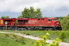 CP 8794 East was traveling around 10-15 mph when I took this photo. In another couple hundred yards they stopped so the crew could run for a coffee.<br /> <br /> I'm assuming there was some sort of blockage up the track as the RTC (Rail Traffic Control) told them to stop for a coffee.<br /> <br /> I've never taken a photo from this location before so I was interested as to how things would look. I think there are a few too many distracting elements in the area, such as the fence. To the left of the photo is the Domtar mill (Dryden).