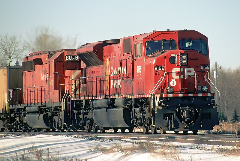 A SD90MAC and a SD-40-2, CP 9156 leads as CP 6078 trails with a broken number board. 6078 is also a 'slug'.