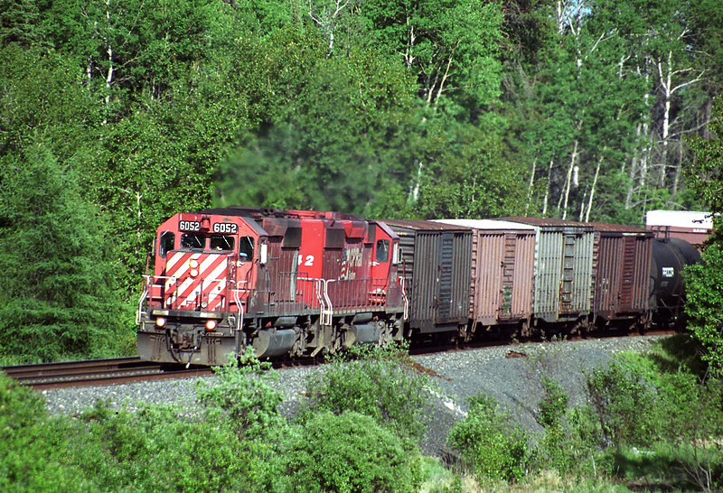 CP 6052 at Barclay Ontario. Train was 1/2 mile from the camera. Film camera used, then negative scanned.