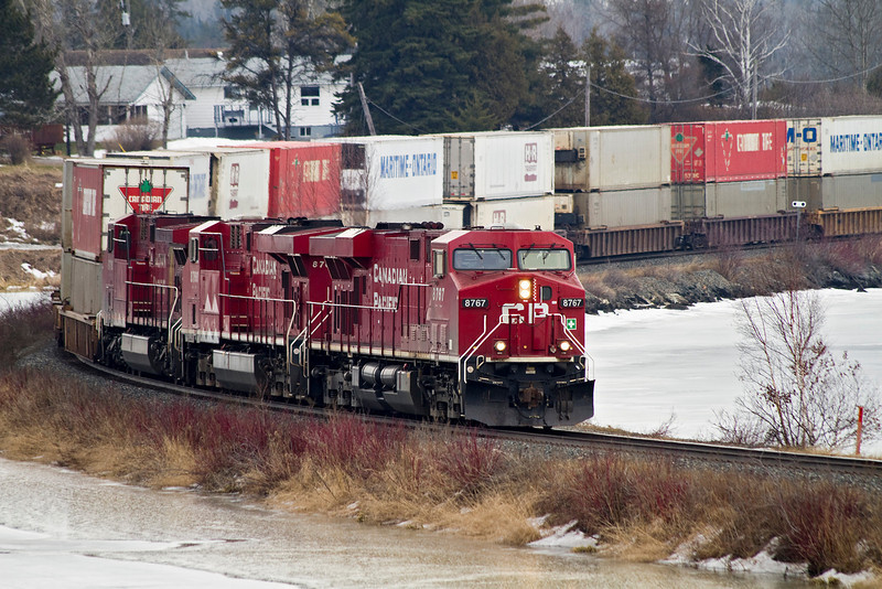 CP 8767, a GE ES44AC, pulls a container train through Wabigoon Ontario.CP  8767 was followed by CP 8766 and CP 9716 with CP 8808 mid-train.