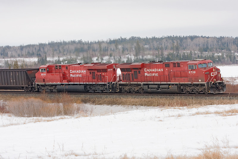 CP 8730 pulling coal empties westward. Photo taken at MP 71, Ignace Subdivision (west of Dryden, Ontario).