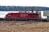 This GE ES44AC, CP 8806 was seen mid train going through Wabigoon Ontario.