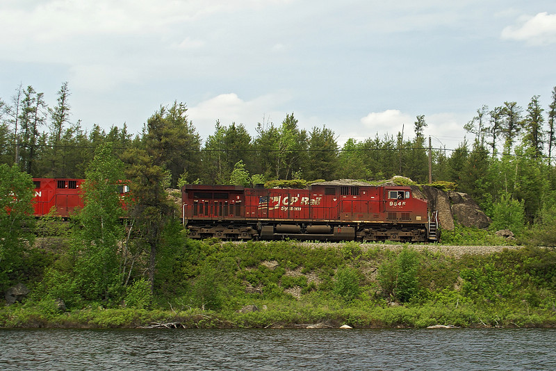 CP 9545 and 8615 heading east at North Narrow Lake towards Hawk Lake. Photo taken near mile post 124 and while in my kayak.<br /> <br /> North Narrow Lake is right beside the highway, about 35 kilometers east of Kenora, Ontario.<br /> <br /> Not only did the engineer wave, but he also blew the whistle for me.