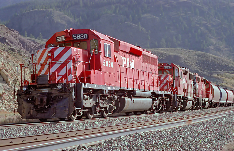 CP 5820, a SD-40-2, waits for a meet on the CN line. This CP train is on the CN line due to a derailment. I was the trainman on this trip.<br /> <br /> Film camera used (AGFA XRG 200 film), then scanned with a Nikon Coolscan IV ED.