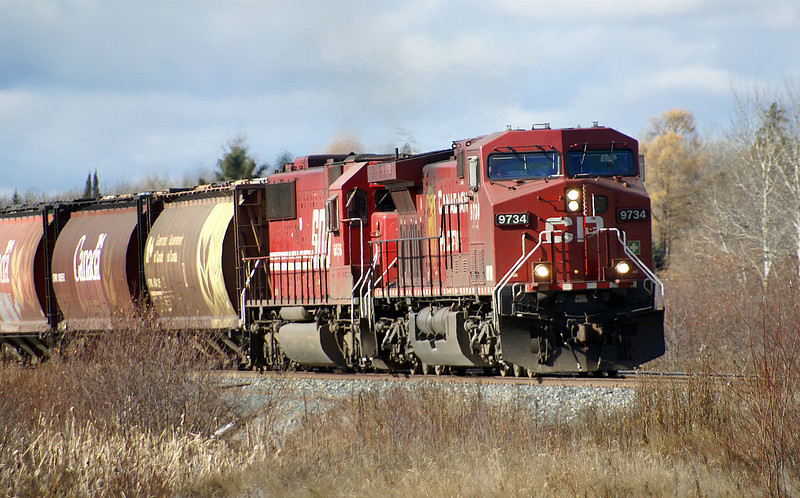 CP 9734 and SOO 6056 at Island view Road crossing hauling grain to Thunder Bay.