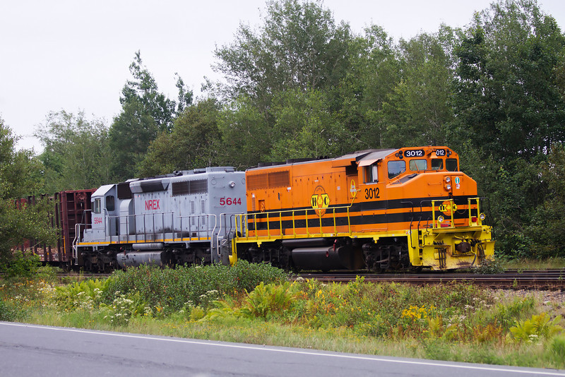 On our way back home from our trip to the east coast, I saw this train sitting in a siding next to the highway so I stopped quickly to get a photo. Taken in Western Ontario. Huron Central unit 3012, a GP40-2L(W), trailed by NREX 5644.