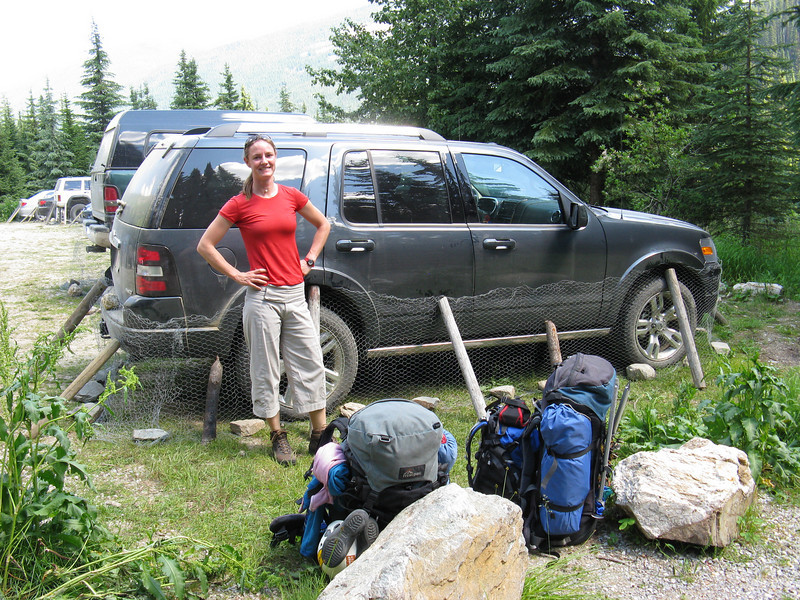 Kate, our packs and the car in the carpak at the start of the hike up to the Bugaboos. Note the chicken wire and logs around the car to protect it from animals who like to eat the fuel lines and other rubber bits !!! nice !!!