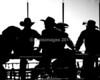 Cowboys hanging out at the chutes