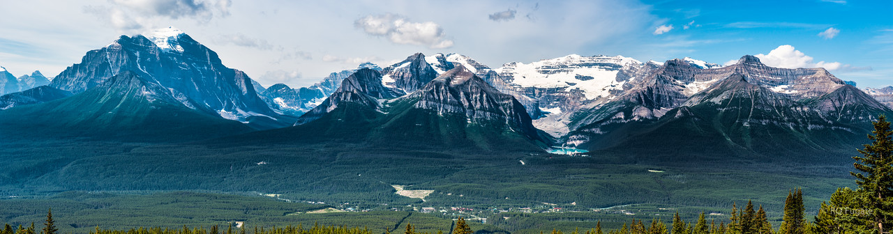 View from the summit of the Lake Louise Gondola and Chairlift. Note Lake Louise right of center. I think the big mountain to the left is Mt. Temple at 11,626 ft. The mountain behind Lake Louise is Mt. Victoria at 11, 362 ft. View at Original size and pan across the image for lots of detail.