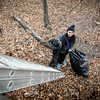 UMass Lowell student, Srividya Kuppa stands at the bottom of the 30 foot ladder that brings them down to the canal with bags of trash picked up along the canal. SUN/Caley McGuane