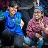 From left, UMass Lowell students Paridhi Saxena and Swati Dileep are all smiles after cleaning up the canal behind the Boot Mills. SUN/Caley McGuane