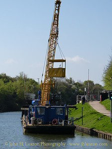 A cruise along the Gloucester and Sharpness Canal April 15 to 17, 2014 on board the MV EDWARD ELGAR operated by English Holiday Cruises.  Canal and Waterway's Trust floating crane at work near Sellars Bridge.