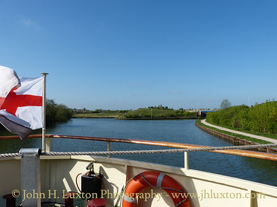 A cruise along the Gloucester and Sharpness Canal April 15 to 17, 2014 on board the MV EDWARD ELGAR operated by English Holiday Cruises.  Approaching Netheridge Bridge constructed in 2005 /6. The old route of the canal can be seen to the left.