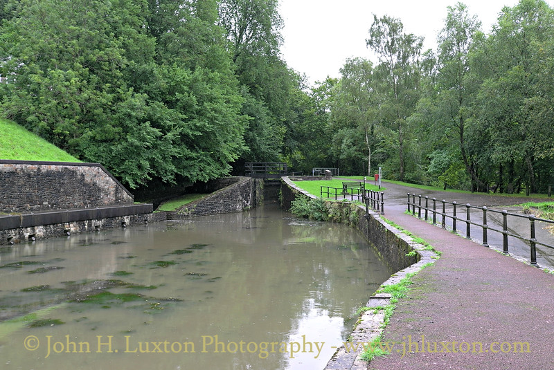 The restored basin at Resolven. At present a section of the Neath Canal beyond Resolven is unrestored and would require the reinstatement of an over bridge on the site of the twin bore culverts (behind the camera) under Commercial Road.