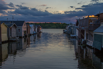 boathouses at city pier at sundown