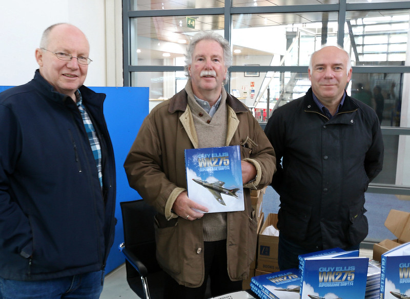 Guy Ellis (author)  and Tim Wood (owner) of WK275 in Hangar 3 signing books ahead of a presentation by Chris Wilson from Jet Art Aviation who restored the aircraft.<br /> By Correne Calow.