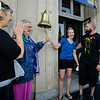Survivor Dawn DeLuca, in blue, is joined by mom Shirley Starzynski, grandmother Evelyn Giammalvo and husband Mike to ring a bell signifying the end of her cancer treatments. SENTINEL & ENTERPRISE / Ashley Green