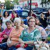 Cancer survivors, their loved ones and supporters listen to speakers on the steps of Leominster City Hall on Tuesday evening. Survivors shared their stories of survival and rang a bell signifying their battle with cancer. SENTINEL & ENTERPRISE / Ashley Green