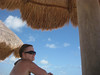 Cheri under our tiki hut on the beach