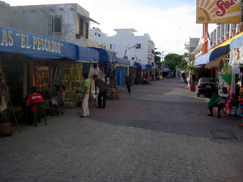 Side street in Playa del Carmen.  One quickly learns to walk--not stroll--and avoid eye contact with the street vendors.