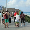 The line of people waiting to get their picture taken in front of the CANCUN sign