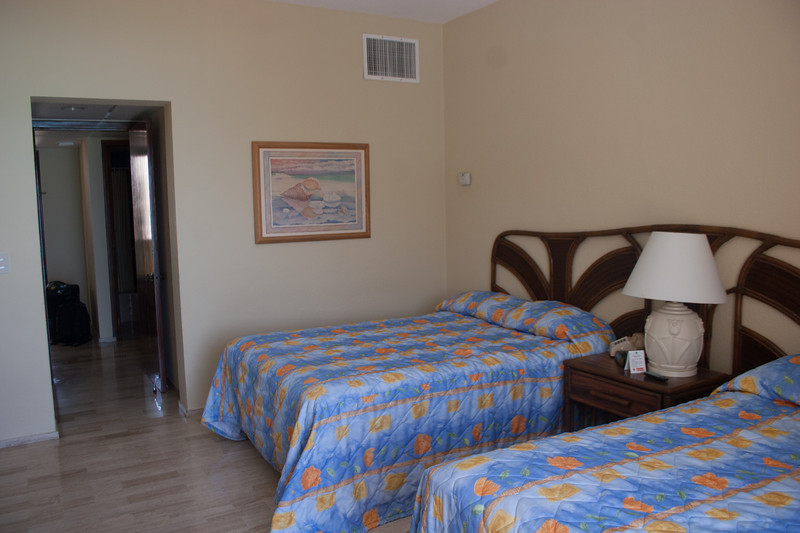 Two full beds are part of the lock-off decor.