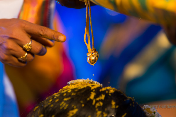 Mangal sutra - which is tied to the neck of the bride by the groom during their wedding.