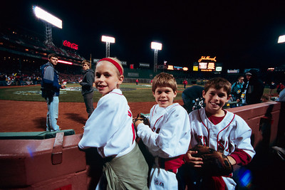 "2008 ALCS, Game 5 - If you walk around Fenway Park with any large-ish camera, and a ticket in a placard, people will think you are the press.  These children's custodian insisted I take their photo.  ""Sure, why not."""
