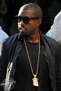 Kanye West Shows Off Gold Jesus Pendant