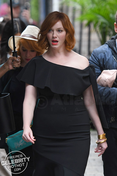 Christina Hendricks Fashions Off The Shoulder Black Dress and Bright Red Lipstick