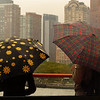 Sitting inside the ferryboat because of the rain, I spotted this interesting pair of umbrella's on display right in front of me, and they coaxed me to pull my point n' shoot camera out of my backpack.