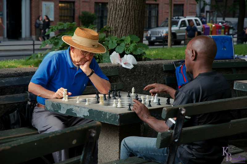 I absolutely loved this scene when I came across it at Washington Square park. The weathered table, mismatched chess pieces, and great straw hat. The scene felt so Americana I literally had the camera up to my face before I even realized I was doing it. Then I waited for a moment when one of them was moving hoping it wouldn't be the old man, as his pose was absolutely perfect.