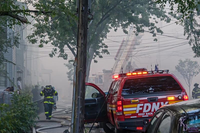 The smoke from the fire was all encompassing to anyone standing on any part of this block on Benziger.  At first the hazy smoke just engulfed the homes on fire on the right, but soon it spread up down and across the street. In short order only the closest homes to me weren't totally shrouded in that foul smoke.