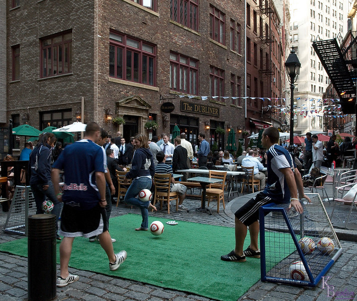 It was June 11th start of the World Cup, and soccer fever had arrived at the City's shore. Here in the Wall Street district, at a spot I call Pub Alley, some kids shared their enthusiasm for their sport.