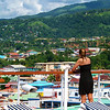 The view of Dominica from the back of our ship was stunning, and I raced through the maze of deck chairs hoping to capture this fellow cruise mate gazing at the beautiful cottage dotted hills in the background. When I showed her this picture she loved it just as much as I did.