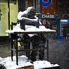 The 2nd blizzard of February was giving us some of it's worst, when I passed through midtown and saw this young lady put down her things and pose next to this statue tribute to the garment working industry. I liked the couples spirit to capture shots even through all this snowy mess - just like we fellow photogs.